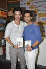 Sushant Singh Rajput, Raj Kumar Yadav at Kai po che DVD launch in Infinity Mall, Mumbai on 10th May 2013 (78).JPG