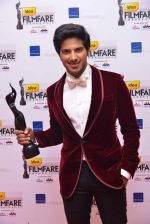 Dulquer Salmaan with his award for Best Debut (Male) at the 60th Idea Filmfare Awards South.jpg