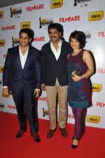 Naga Chaitanya, Nagarjuna and Amala on the Red Carpet of _60the Idea Filmfare Awards 2012(South)..jpg