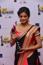 Priyamani received Best Actress Award for Charulatha (Kannada).jpg