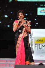 Priyamani receives the Best Actor - Female award for the movie Charulatha from Lakshmi Manchu and Jagapathy Babu during the 60th Filmfare Awards..jpg