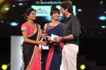 Priyamani receives the Best Actor - Female award for the movie Charulatha from Lakshmi Manchu and Jagapathy Babu during the 60th Filmfare Awards.jpg