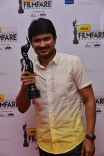 Udhayanidhi Stalin received award for Best Debut (Male) for Oru Kal Oru Kannadi (OKOK) (Tamil).jpg