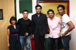 RJ Meera and RJ Suren of Sunset Samosa with Aamir Khan, Abhishekh Bachchan and Uday Chopra at Radio Mirchi studio for promotion of Their upcoming movie Dhoom 3_52b16dcfc5b29.JPG