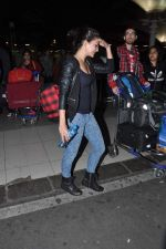 Jacqueline Fernandez snapped at the airport in Mumbai on 5th Jan 2014