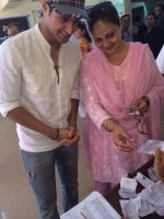 Tanuj Virwani and mother Rati Agnihotri step out to vote on 24th April 2014 (6)_535a39a5e4d0c.jpg
