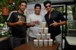 Olympian Swimmer Rehan Poncha, HP Founder Rohan Mirchandani, Actor Tanuj Virwani at the Launch of Hokey Pokey Ice-creams in Retail Packs on 26th April 2014 (2)_535e0303378b7.jpg