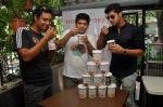 Olympian Swimmer Rehan Poncha, HP Founder Rohan Mirchandani, Actor Tanuj Virwani at the Launch of Hokey Pokey Ice-creams in Retail Packs on 26th April 2014 (4)_535e0389418a9.jpg