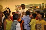 Keron Pollard promotes Addidas with kids in Palladium, Mumbai on 24th May 2014 (34)_5381c21ec8014.JPG