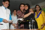 Cyril Dsouza with Rakhi Sawantand Zeenat Qureshi  Distributing Sewing Machines (10)_53f092d90d06e.JPG