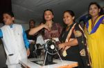Cyril Dsouza with Rakhi Sawantand Zeenat Qureshi  Distributing Sewing Machines (11)_53f092db602ef.JPG