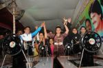 Cyril Dsouza with Rakhi Sawantand Zeenat Qureshi  Distributing Sewing Machines (12)_53f092ddc44f4.JPG
