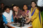 Rakhi Sawant Distributing Sewing Machines  (10)_53f092f7b3f78.JPG