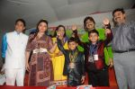 Rakhi Sawant Distributing Sewing Machines  (2)_53f092e520c66.JPG