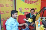 Siddharth Anand & Hrithik Roshan at Radio Mirchi studio for the success of Bang Bang!_543cd4bddfb00.jpg