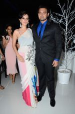 Evelyn Sharma, Mahakshay Chakraborty at the Launch of Karan Johar_s special edition Holiday Line by Gehna Jewellers in Mumbai on 13th April 2015 (36)_552cede8be339.JPG