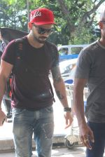 Virat Kohli snapped at Mumbai Airport on 1st May 2015