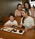 Amrita Arora showing her bakery expertise to Alesia Raut