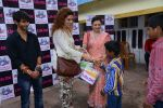 Dhruv Raj Sharma, Tanaz Irani & Anita Kanwal giving gifts to the kids at Life OK launches Zindagi Abhi Baki Hain_55d2e42d75a63.JPG