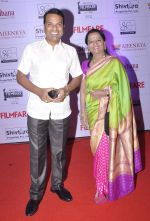 Bharat Jadhav with wife at the Red Carpet of _Ajeenkya DY Patil University Filmfare Awards