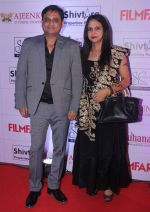 Meenakshi Singh with her husband at the Red Carpet of _Ajeenkya DY Patil University Filmfare Awards