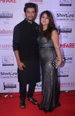 Sharad Kelkar with his wife at the Red Carpet of _Ajeenkya DY Patil University Filmfare Awards