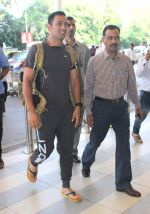 Mahendra Singh Dhoni snapped at airport on 12th Dec 2015