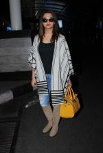 Surveen chawla snapped at airport on 19th Dec 2015