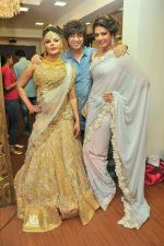 Rakhi Sawant with Rohit Verma and Priyanka Shah at the launch of Rohit Verma