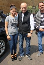 Sunidhi Chauhan, Anupam Kher snapped at airport on 9th Feb 2016