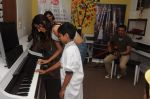 Monica Dogra and Ehsaan Noorani jam with kids of  Akanksha Foundation at the event organised by COLORS Infinity and Furtados School of Music_56c41aa7da922.JPG