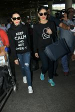Karisma Kapoor, Kareena Kapoor snapped at airport on 19th March 2016