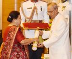 Kokilaben Ambani recieving Padam Shri award from President Pranab Mukherjee on 28th March 2016