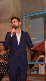 Virat Kohli in Mayyur Girotra for a book launch on comfort food in Delhi on 1st June 2016