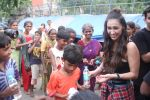Lauren Gottlieb snapped interacting with street kids on 9th June 2016 (8)_575a82af56e30.JPG