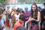 Lauren Gottlieb snapped interacting with street kids on 9th June 2016 (9)_575a82afce49e.JPG