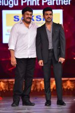 Chiranjeevi with son Ram Charan on stage at the Maa awards in HICC Hyderabad on 12th June 2016 (2)_575ee703e8d2e.jpg