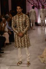 Models walk the ramp displaying Rohit Bal_s latest collection Kehkashaan at the India Couture Week 2016 on July 24, 2016 (11)_579621f680a03.JPG