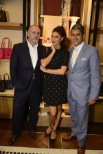 Ian Bickley, President, Coach International, Jacqueline Fernandez and Sanjay Kapoor, Executive Chairman, Genesis Group At The Coach Launch Celebrations