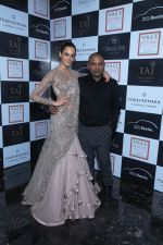Designer Gaurav Gupta posing with his model at Vogue Wedding Show 2016 at Taj Palace New Delhi (1)_57a5651453596.JPG