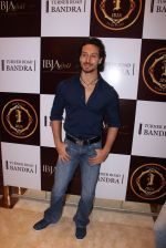 Tiger Shroff during the launch of India_s first customized gold coin store IBJA Gold, in Mumbai on 7th Sept 2016 (74)_57d11004365cd.JPG