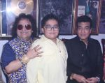 Bappi Lahiri, Swastik Bansal and Jeetendra at Bappi Lahiri_s Lakshmi Pooja at the Lahiri House in Juhu_5806255ea8aa6.jpg