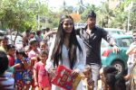 Poonam Pandey Distribute Raincoat To Neddy Kids on 30th May 2017 (37)_592ebf1a0a7f2.JPG
