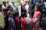 Poonam Pandey Distribute Raincoat To Neddy Kids on 30th May 2017 (53)_592ebf369c7ec.JPG