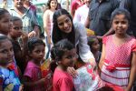 Poonam Pandey Distribute Raincoat To Neddy Kids on 30th May 2017 (55)_592ebf3a76457.JPG