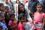 Poonam Pandey Distribute Raincoat To Neddy Kids on 30th May 2017 (56)_592ebf3c52e6b.JPG