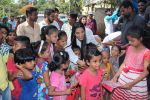 Poonam Pandey Distribute Raincoat To Neddy Kids on 30th May 2017 (58)_592ebf406f550.JPG