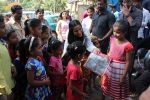 Poonam Pandey Distribute Raincoat To Neddy Kids on 30th May 2017