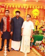 Rajesh Kalyanaraman Executive Director Kalyan Jewellers, Actor Mammootty  and T.S. Kalyanaraman Chairman Kalyan Jewellers at the Navratri party of the Kalyan Jewellers family_59c9cc4f6ff26.jpg