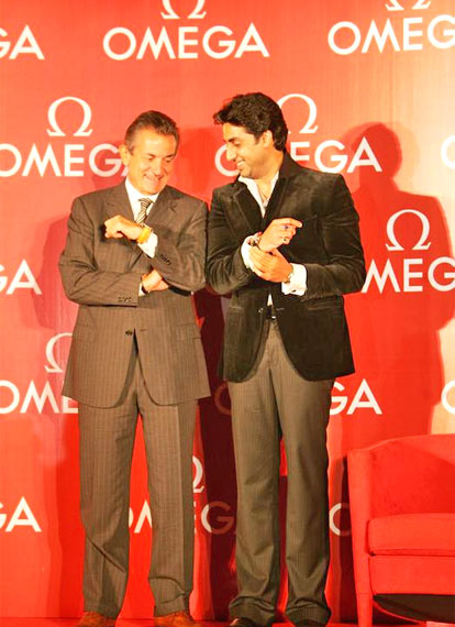 Abhishek Bachchan and Stephen Urquhart, President, Omega, pose with their Omega watches